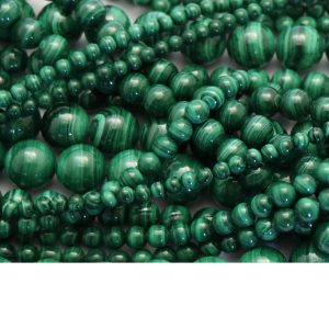 malachite strand smooth round stones group image