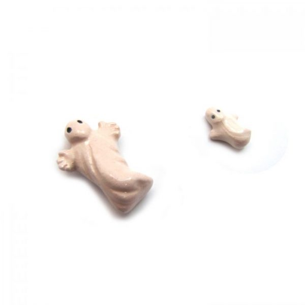 ghost large and small ceramic beads laying down