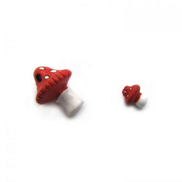 ceramic beads large and small mushroom laying down side view