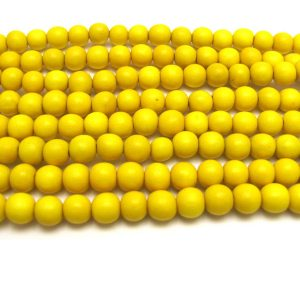 yellow - coloured wood smooth rounds