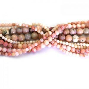 Pink puruvian opal strand smooth round stones group image