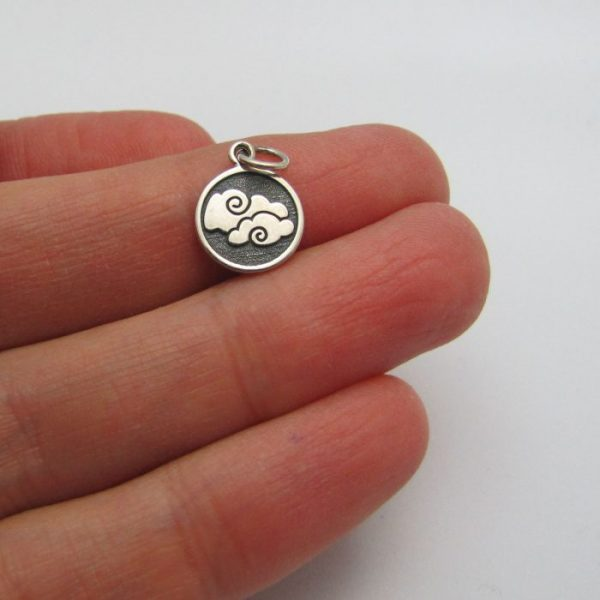 air element tag front of charm sterling silver in hand to show scale